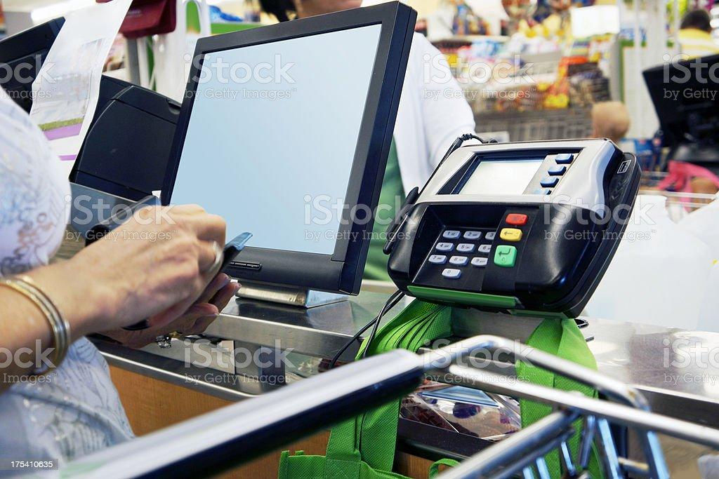 Supermarket paying royalty-free stock photo