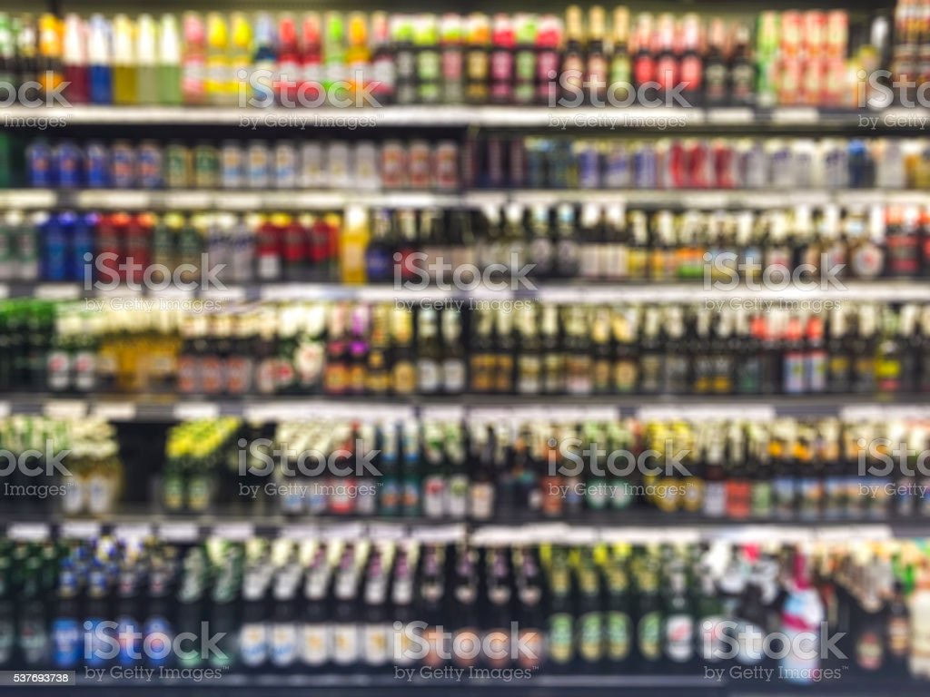 Supermarket shelf defocus background stock photo