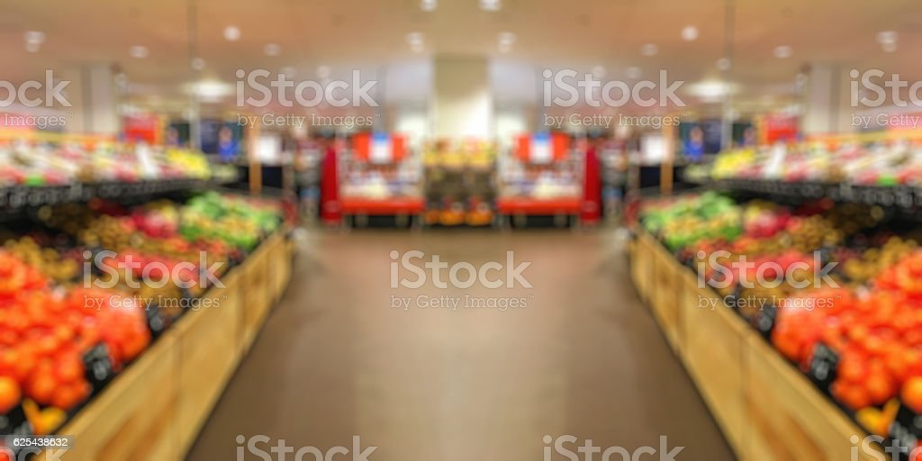 Supermarket shelf interior blured background stock photo