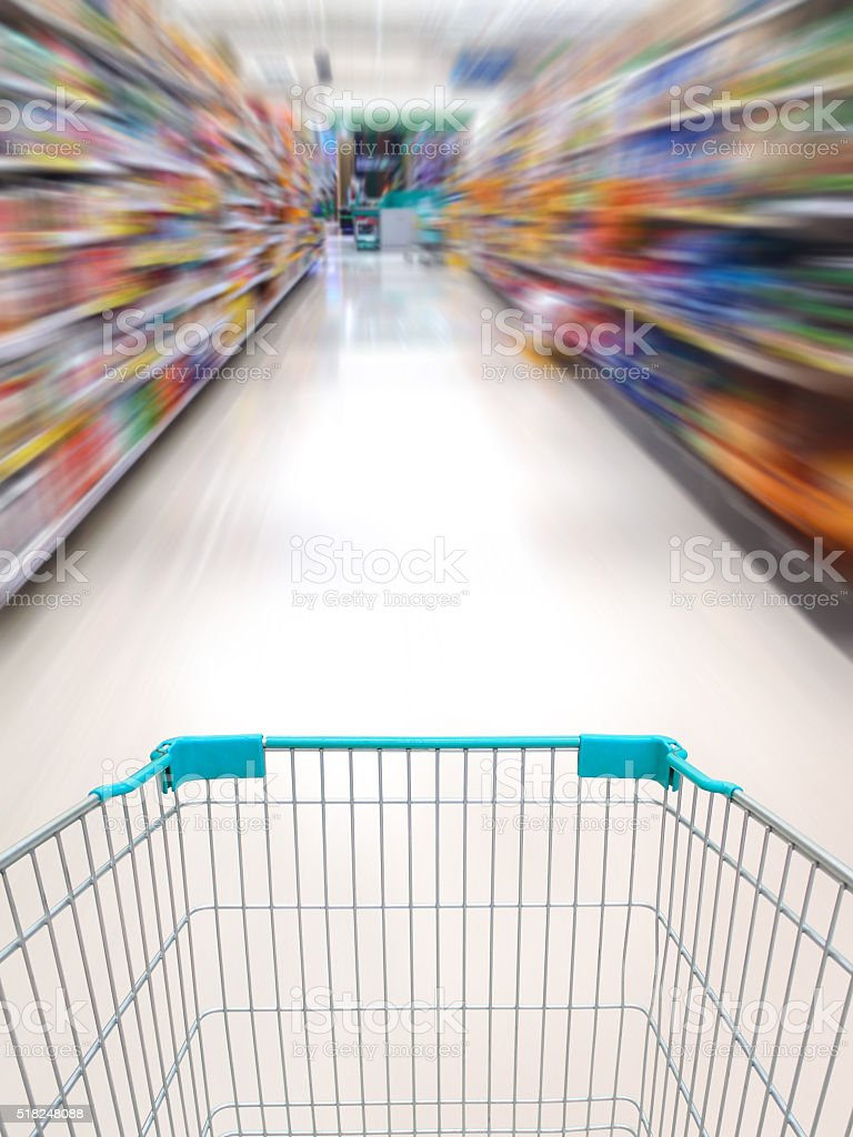 supermarket shelves aisle blurred background stock photo