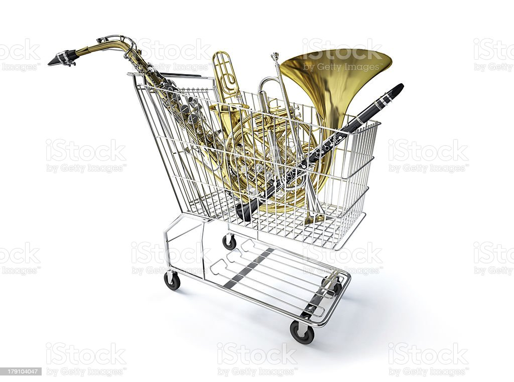 Supermarket trolley, full of wind musical instruments. stock photo