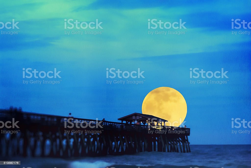 Supermoon at Myrtle Beach State Park Pier stock photo