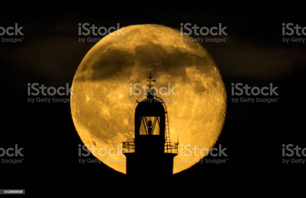 supermoon full moon lighthouse backlight far illes medes zoom fullmoon stock photo