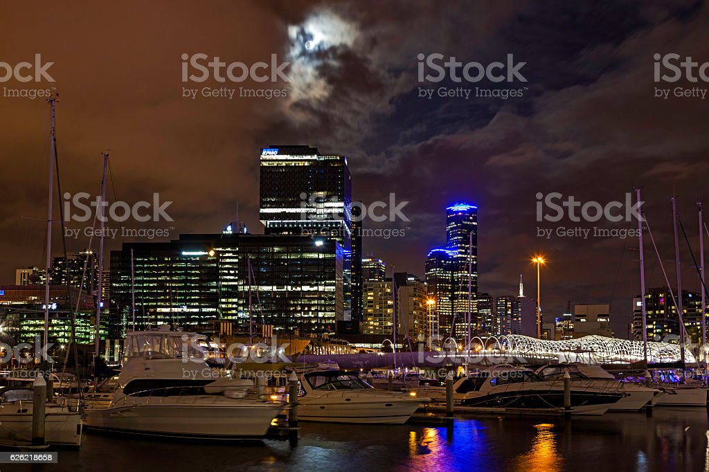 Supermoon makes brief appearance over Melbourne's Docklands stock photo