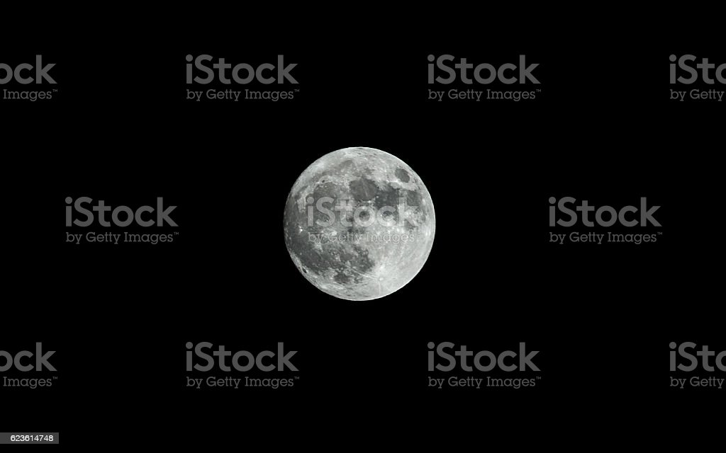 Supermoon or Fullmoon Isolated Against Dark Night Sky stock photo
