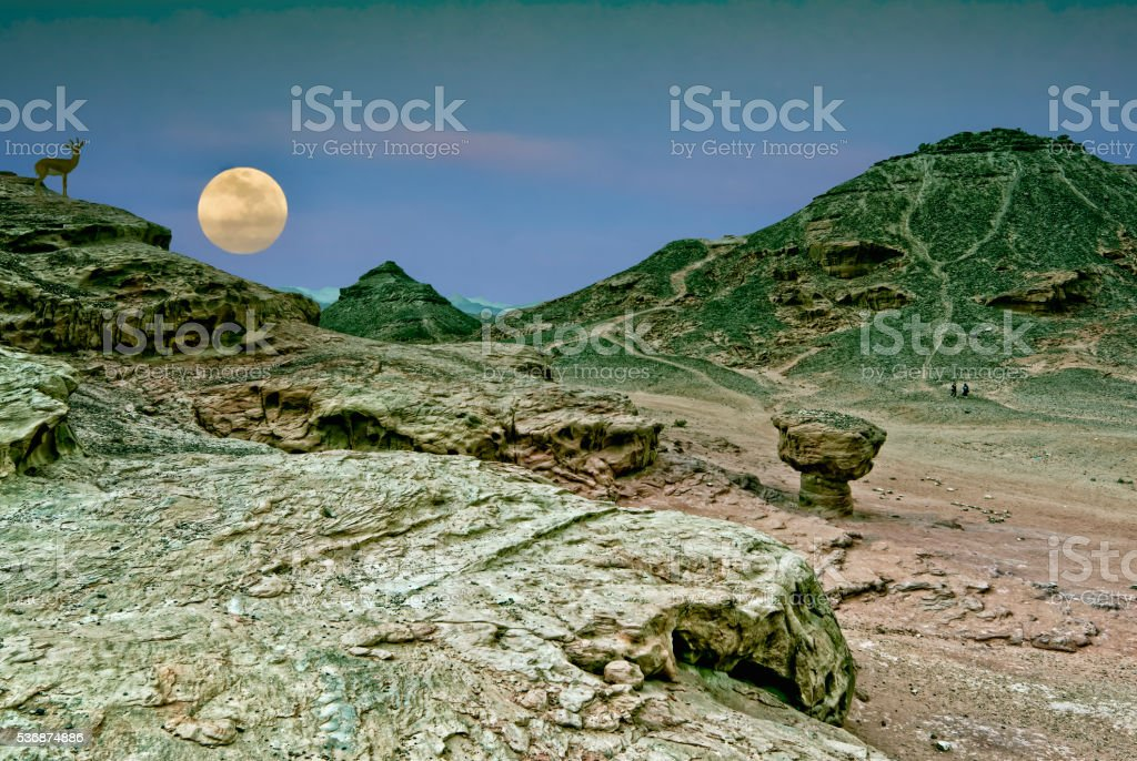 Supermoon rise in  nature desert park of Timna, Eilat, Israel stock photo