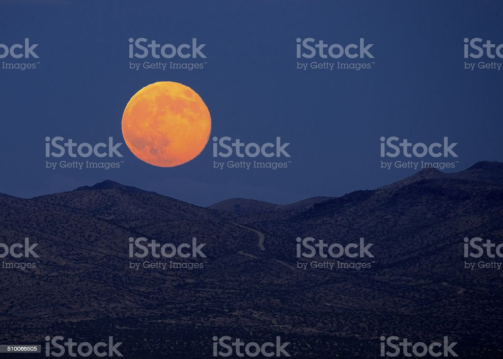 Supermoon rising stock photo