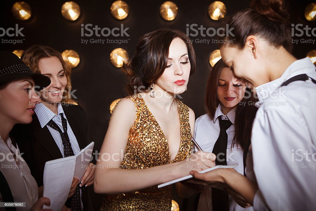 Superstar woman crowded by paparazzi stock photo