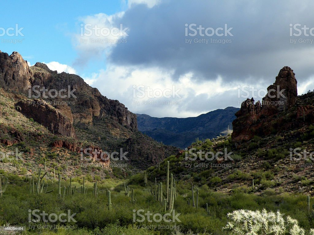 Superstion Mountains and stormy sky stock photo