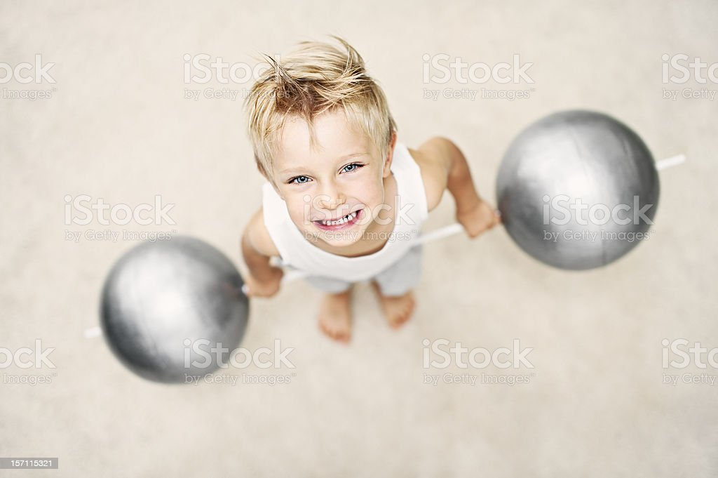 Super-strong boy stock photo