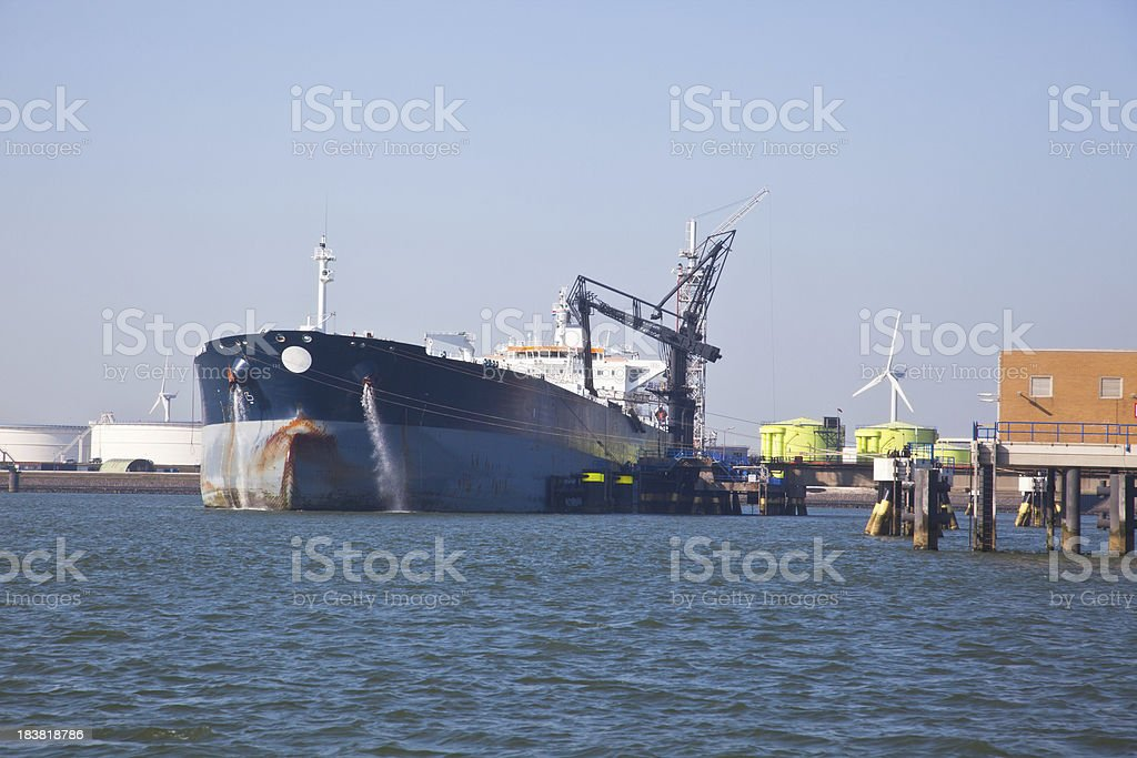 Supertanker with oil storage tanks royalty-free stock photo