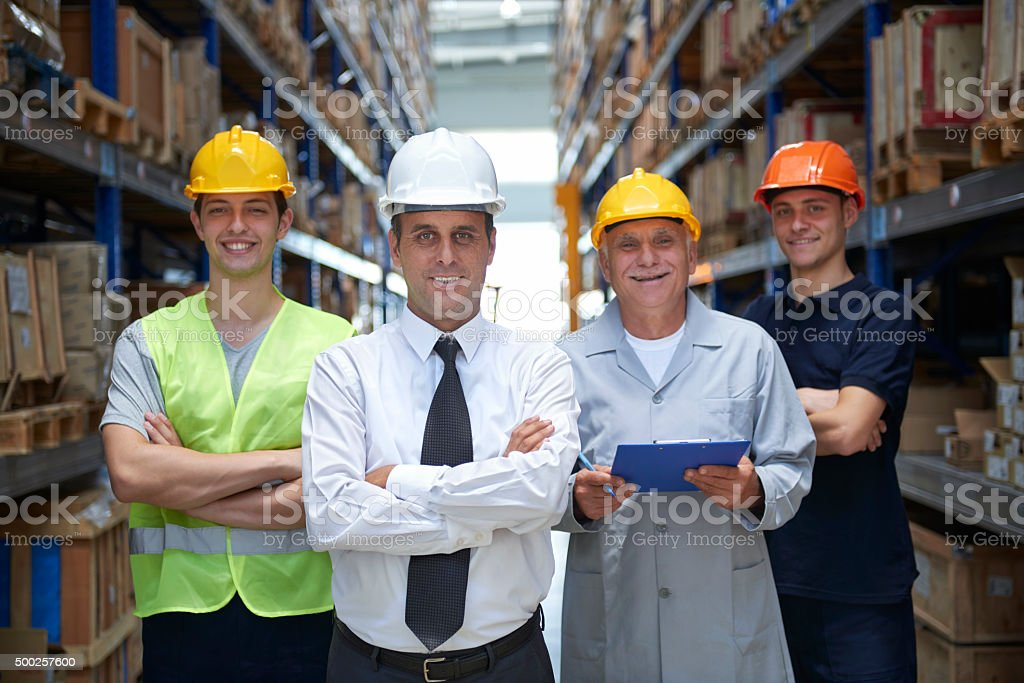 Supervisor and workers in warehouse stock photo