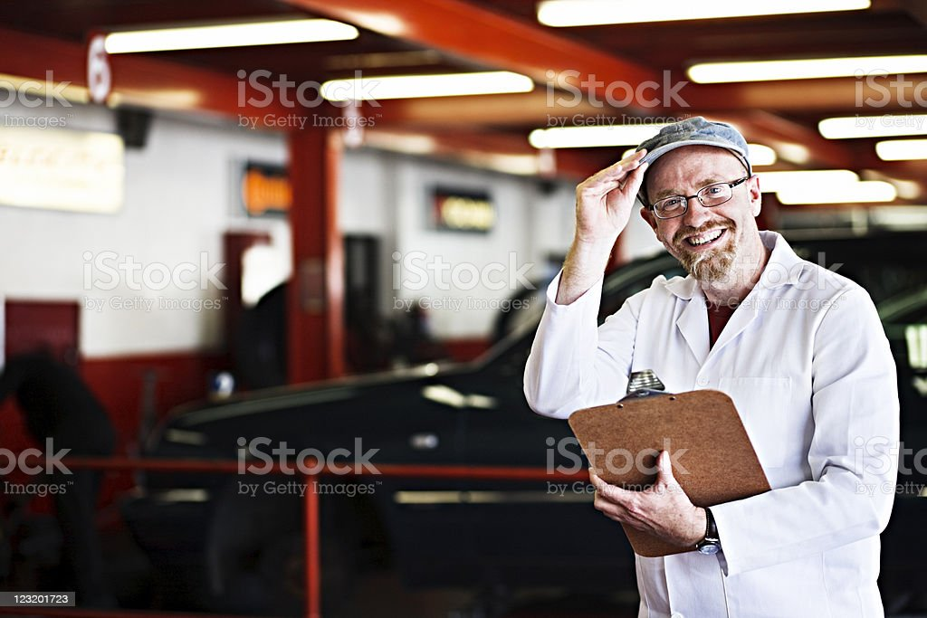 Supervisor at auto workshop royalty-free stock photo