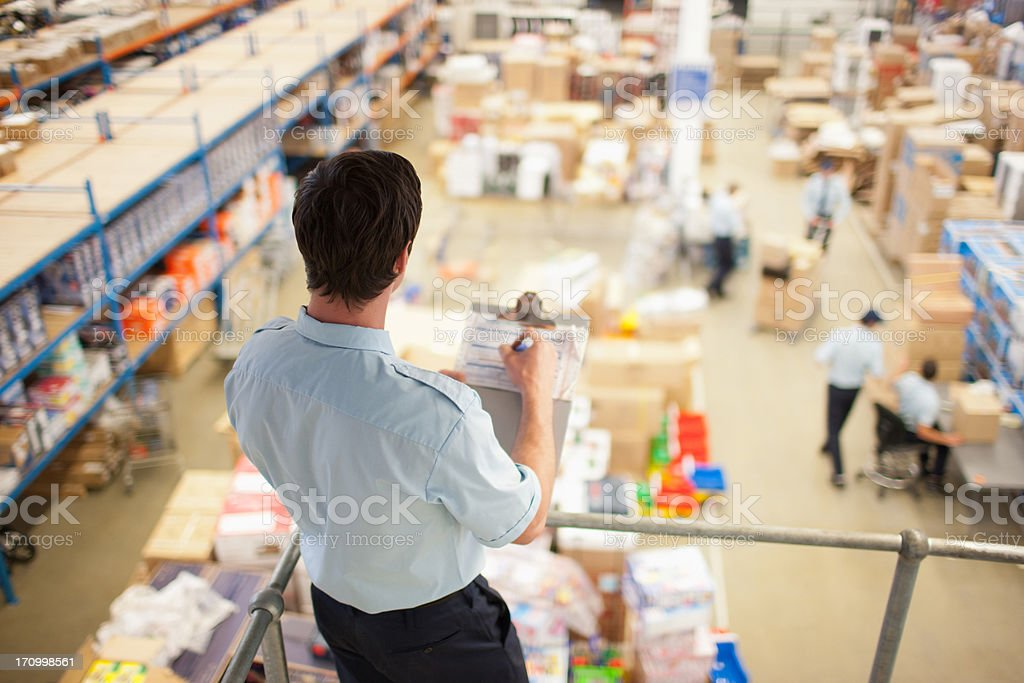 Supervisor  monitoring shipping work stock photo