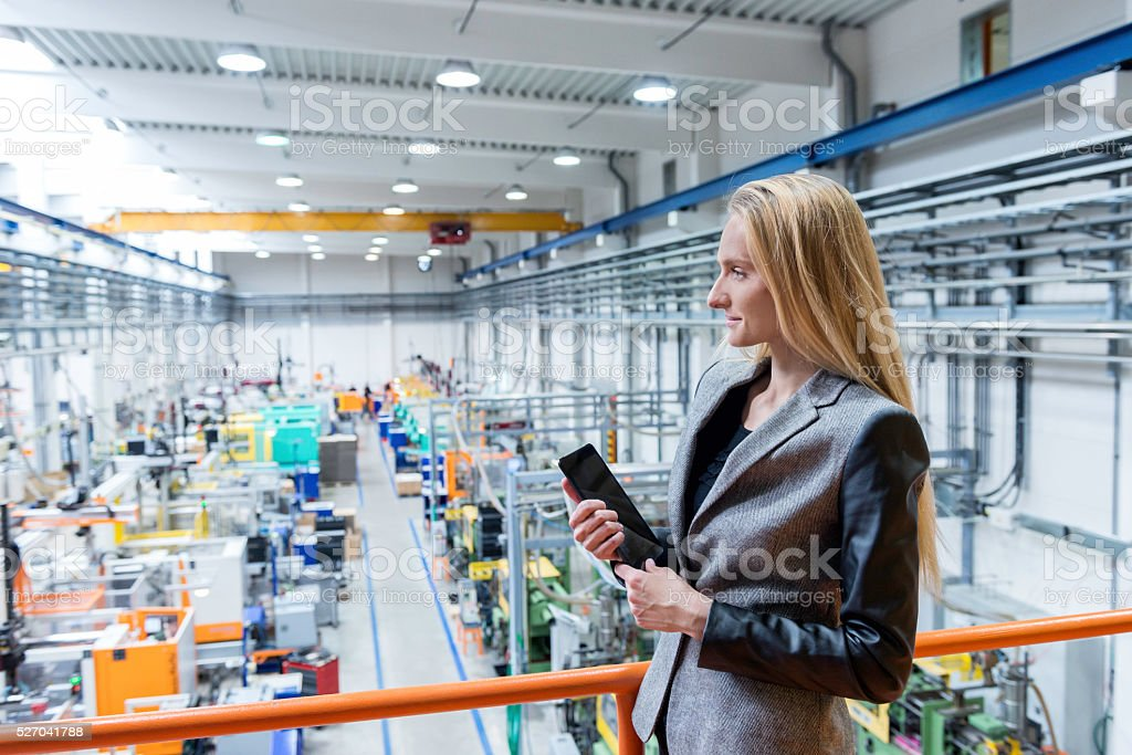 Supervisor on top in modern facotry stock photo