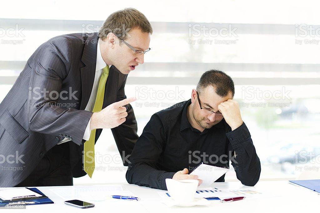 Supervisor scolding his subordinate stock photo