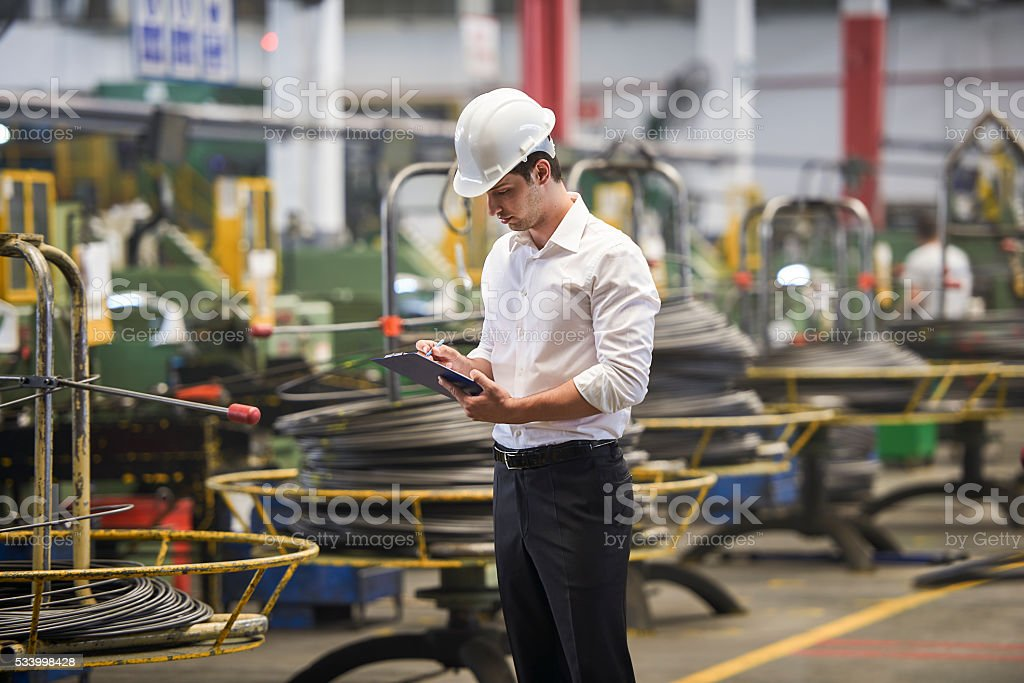 Supervisor working in factory stock photo