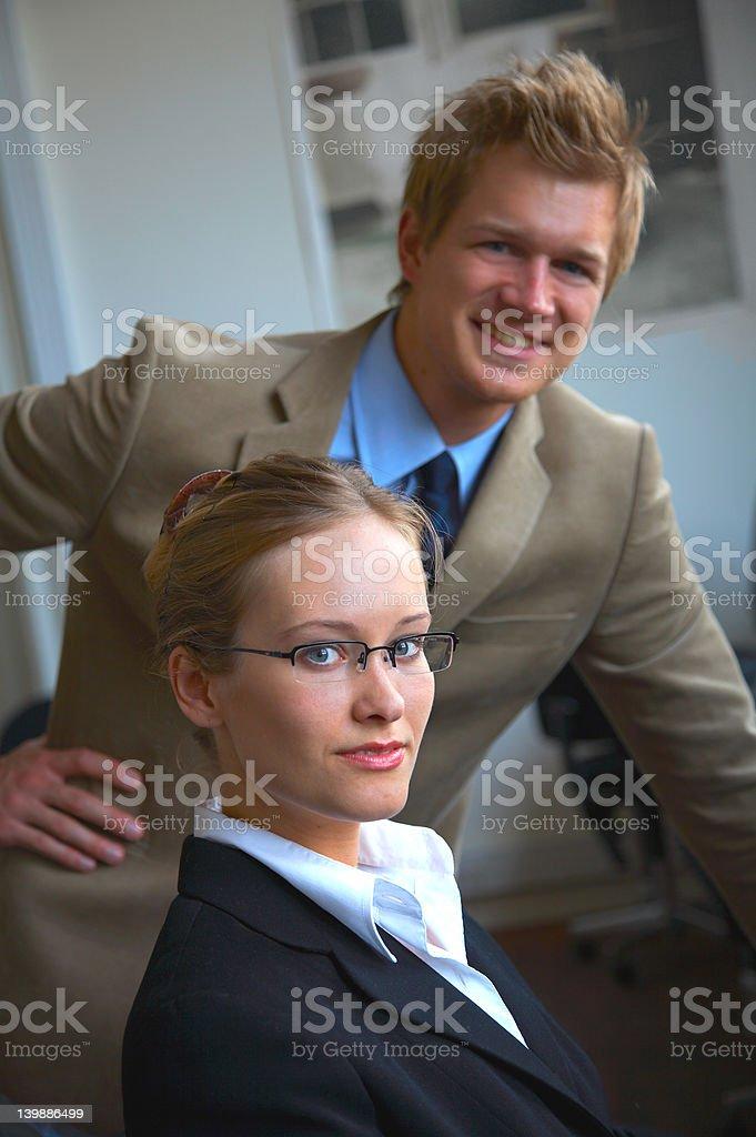 Supervisor - Young man guiding his colleague royalty-free stock photo