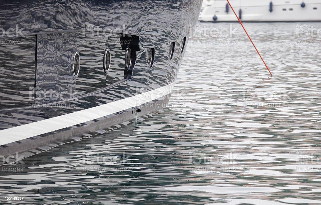 Superyacht hull reflections stock photo