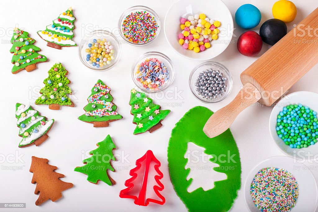 Supplies for preparing Christmas cookies decoration on a white table stock photo