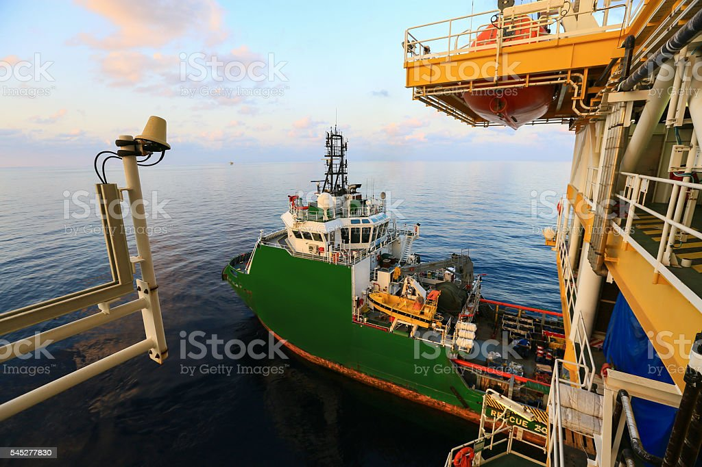 Supply boat transfer cargo to oil and gas industry stock photo