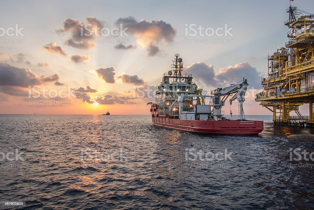 supply boat when sunset stock photo