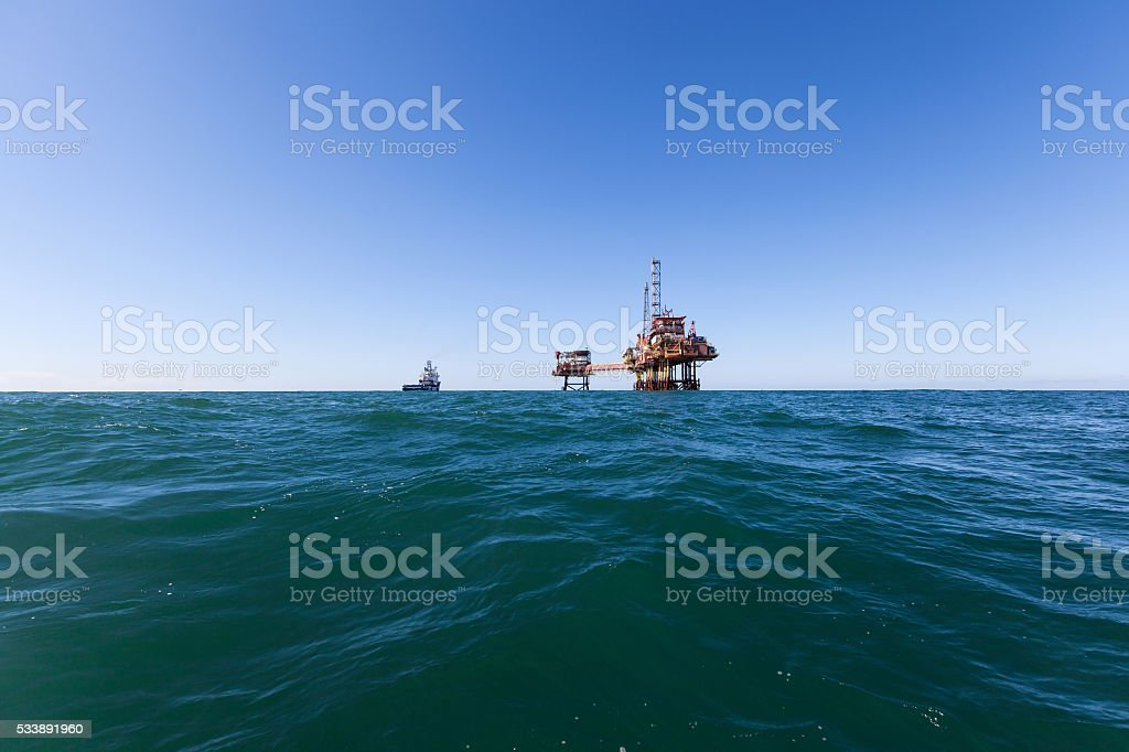 Supply ship and oil platform stock photo
