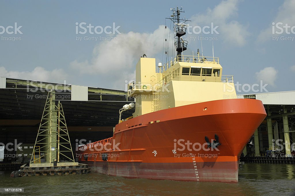 Supply vessel at loading berth stock photo