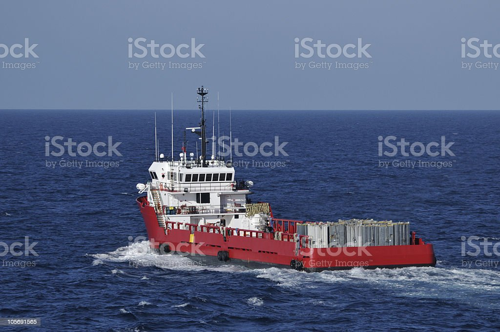 Supply vessel heads to port stock photo