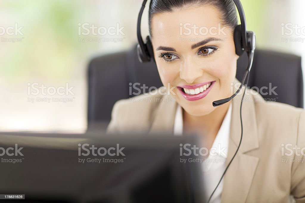 support center operator with headset stock photo