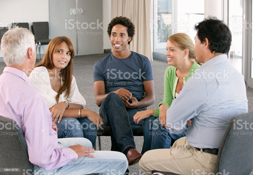 A support group gathering for a meeting stock photo