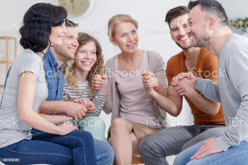 Support group praying stock photo