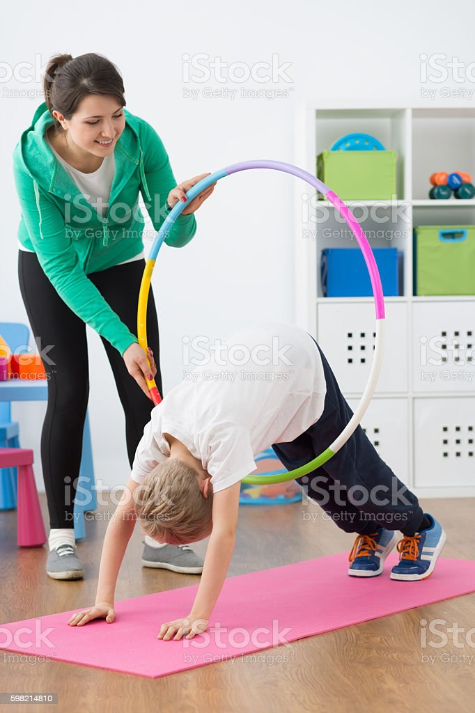 Support him during further exercises stock photo