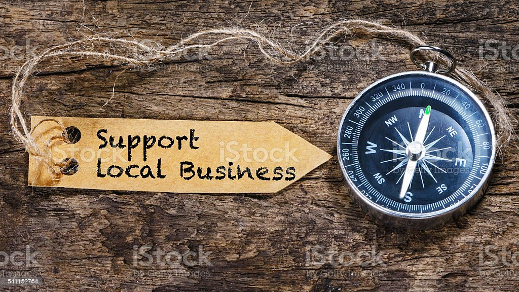 Support local business  business tips handwriting on label with compass stock photo