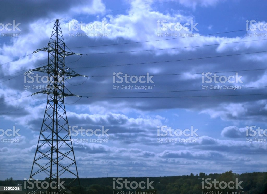Support of the electricity in bright light on a background of the sky stock photo