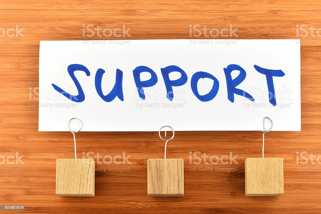 Support, one paper note on wooden background royalty-free stock photo