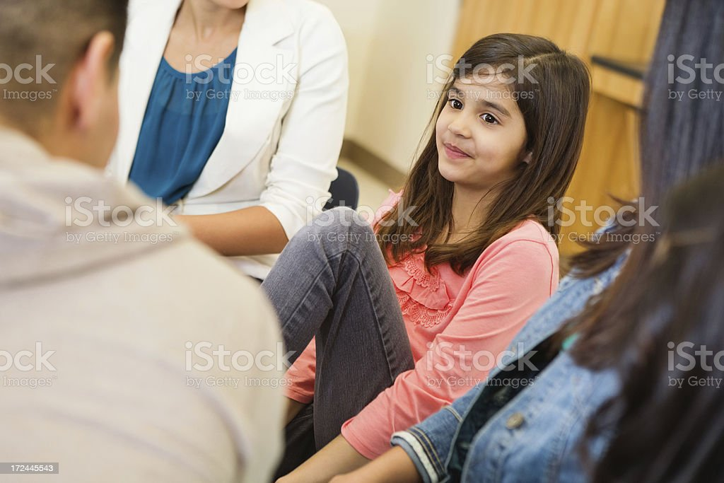 Support or therapy group meeting with children and adults stock photo