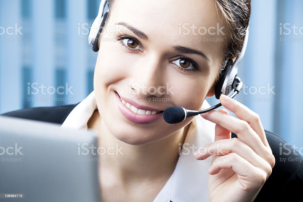 Support phone operator in headset at workplace stock photo