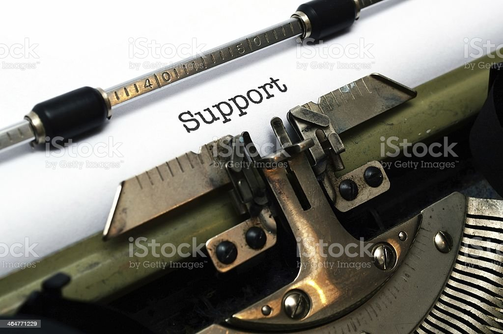 Support text on typewriter royalty-free stock photo