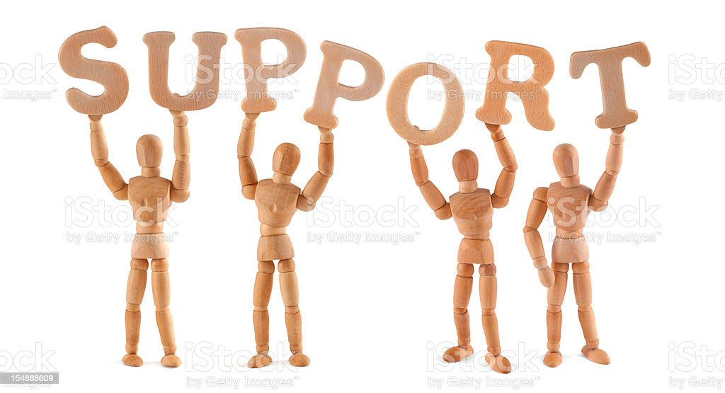 Support - wooden mannequin holding this word royalty-free stock photo