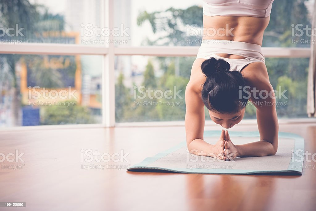 Supported headstand stock photo