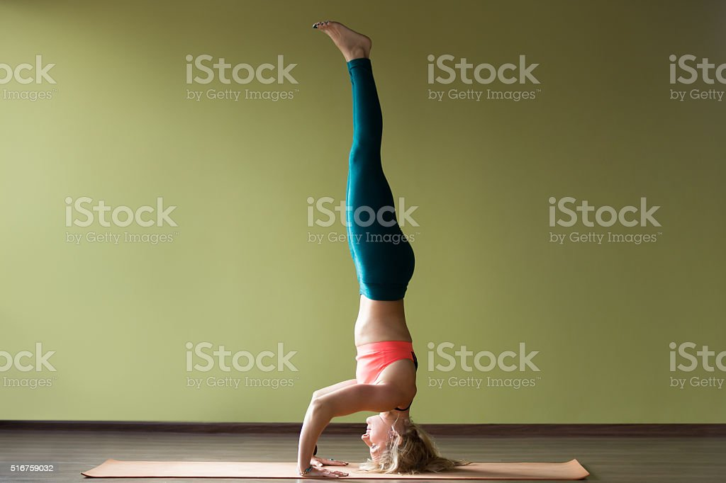 Supported headstand yoga pose stock photo
