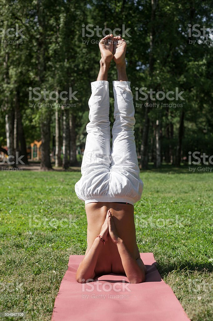 Supported Shoulderstand yoga asana stock photo