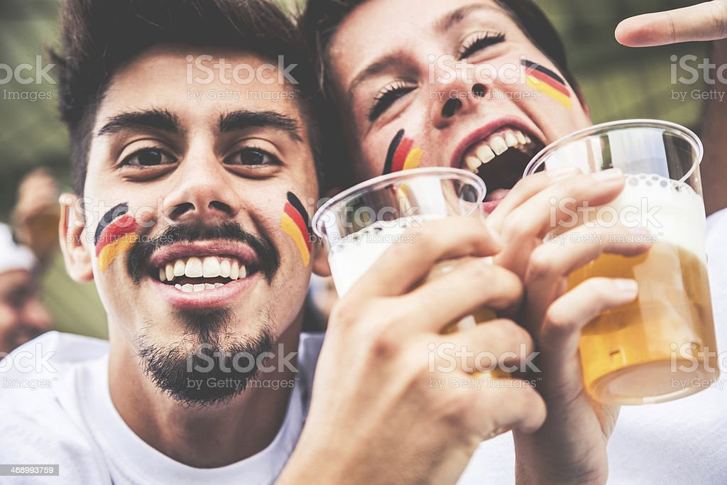 Supporters drinking beer at the stadium royalty-free stock photo