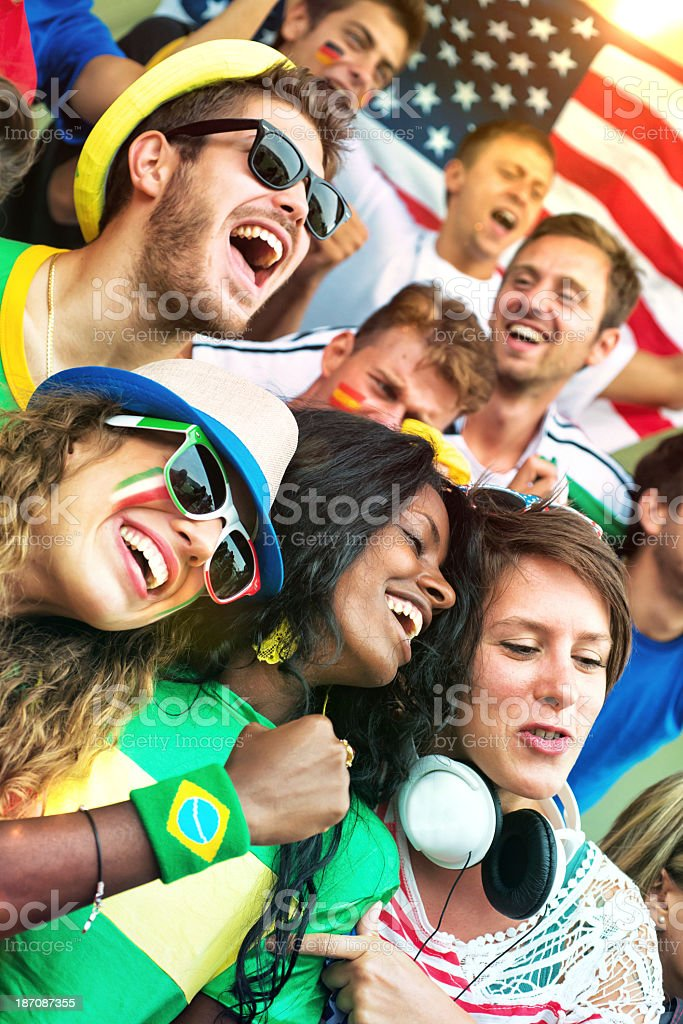Supporters of Different Nationality at the Stadium royalty-free stock photo
