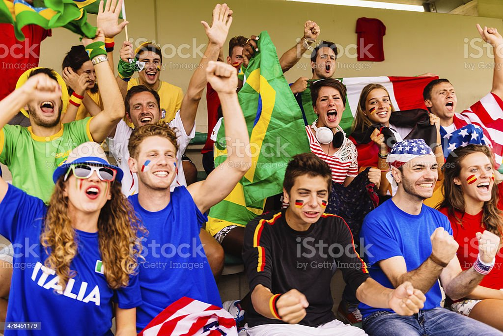 Supporters of different nations at the stadium royalty-free stock photo