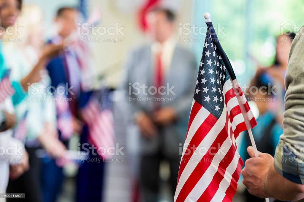 Supporters waving American flags at political campaign rally stock photo