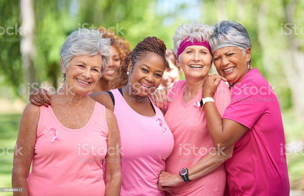 Supporting each other in the race against breast cancer stock photo