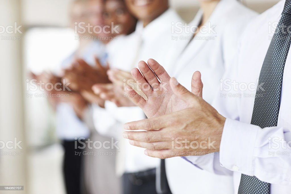 Supportive business people applauding stock photo