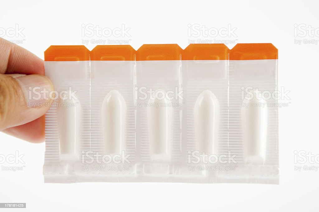 Suppository tablet on white background stock photo